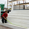 Gloucester: Joey Palazzola, 4, measures the stairs to St. Peter's alter while helping his dad, Chris, at St. Peter's Square Saturday morning. Mary Muckenhoupt/Gloucester Daily Times