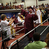 Gloucester: Alexander Crowley raises his arms high in celebration after receiving his diploma during Gloucester High School Graduation in the Benjamin A. Smith Fieldhouse yesterday afternoon. Photo by Kate Glass/Gloucester Daily Times