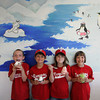 Gloucester: From left, Joey Lombardo, 8, Michael Chinault, 9, Katelyn Chinault, 7, and Serena Lombardo, 8, enjoy their ice cream at Igloo, a new ice cream place on Railroad Avenue, after their last little league game Wednesday evening. Mary Muckenhoupt/Gloucester Daily Times