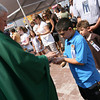 Gloucester: Chad Anthony Noto, 8, receives communion from Bishop Frank Irwin as Silvestro Maniscalco, 6, looks on during the Mass of St. Peter at St. Peter's Square yesterday morning. Photo by Kate Glass/Gloucester Daily Times