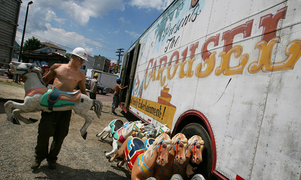 Gloucester: Chris Blamey of Fiesta Shows unloads the horses for the carousel at St. Peter's Square as they set up for the carnival. Photo by Kate Glass/Gloucester Daily Times