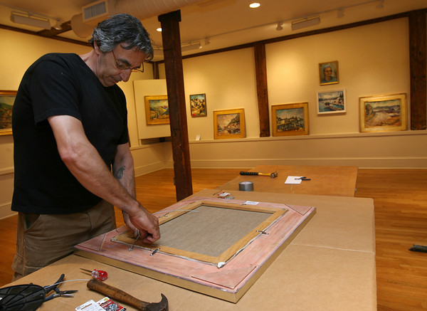 Rockport: Paul Ciaramitaro wires a painting for the Harold Rotenberg Retrospective, which will run from July 15-25th at the Rockport Art Association. The event is in conjunction with his 105th birthday. Photo by Kate Glass/Gloucester Daily Times