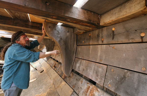 Leon Poindexter of Rockport points out the ship's knees on the Beaver, which he is restoring at Gloucester Marine Railways for the Boston Tea Party Museum. Photo by Kate Glass/Gloucester Daily Times