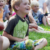 "David Le/Gloucester Daily Times.  Riley Blanchard, 5, of Rockport laughs at a joke told by ""Awesome"" Robb Preskins, also known as Captain Robbie Bones, during his Sky Pirate Show at Millbrook Meadow Park in Rockport on Wednesday afternoon. 6/29/11."
