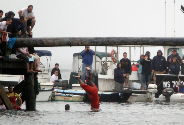 David Le/Gloucester Times. Spectators can only watch as Scott Lane goes headfirst into the water after slipping off the Greasy Pole on Friday evening. 6/24/11.