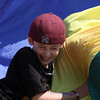 Cal Twombly of Ms. Bruni's 3rd grade class tags out a fellow classmate during a parachute game of cat and mouse at Rockport Elementary School's field day. Photo by Maria Uminski/Gloucester Daily Times