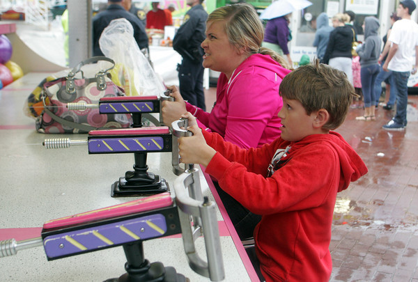 Meghan and Timmy Marrone, 7 of Gloucester play a water racing game at the Fiesta Carnival on Wednesday. Photo by Maria Uminski/Glouester Daily Times