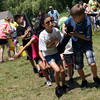 Baylee Kirk and Josh Landry lead the way as their team carries a tube filled with water across the grass at East Gloucester Elementary School during field day on Thursday. Photo by Kate Glass/Gloucester Daily Times