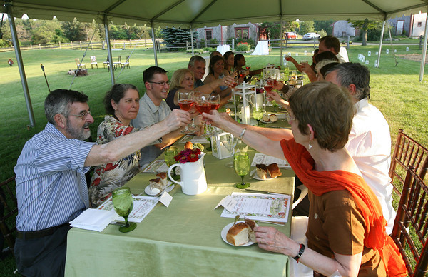 Diners toast to the beautiful evening and delicious food at Frank McClelland's farm to table dinner series, which was held at his home in Essex over the weekend. Photo by Kate Glass/Gloucester Daily Times