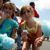 TIM JEAN/Staff photo. Ceriana Edwards-Worthley, 4, left, and Christine Harris, 8, snack on cotton candy at the J.J. Nicastro Foundation Fun Day 4 Kidz Saturday afternoon. The event featured inflatable carnival rides, multiple bounce houses, boxing ring, dunk tank, and fun snacks. All proceeds benefitted the J.J. Nicastro Foundation. 2011