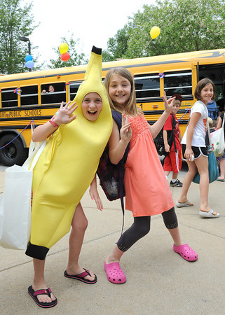 Rockport:  Olivia Theriault dressed like a banana and Macie Wayrynen get ready to board the bus,on the last day at Rockport Elementary School Friday afternoon. Desi Smith/Gloucester Daily Times. June 17,2011