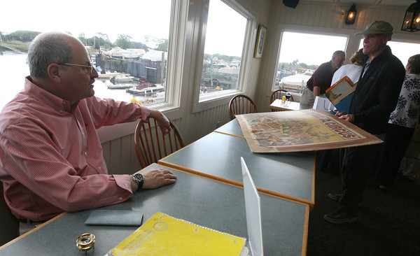 Essex: Vincent Caravella of All Prints and Maps in Essex chats with Dick Clemens of Bullseye Books in the Barn in Rockport about an antique Wallace Brothers 3 Ring Circus poster he brought to the 3rd Annual Antique Appraisal Night at Periwinkles Restaurant last night. Photo by Kate Glass/Gloucester Daily Times