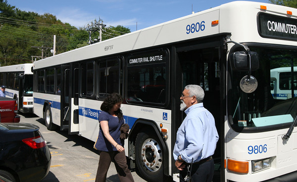 Commuters board shuttle buses at the West Gloucester Commuter Rail Station yesterday as work on the Annisquam River railroad bridge have suspended train service between West Gloucester and Rockport. Photo by Kate Glass/Gloucester Daily Times