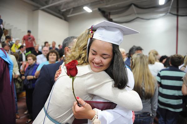 Gloucester: Ellida Cornavaca gets a big hug from her mother Janice Reiloi at the end of Graduation Sunday afternoon at the Benjamin A. Smith Fieldhouse.   Desi Smith/Gloucester Daily Times. June 12,2011