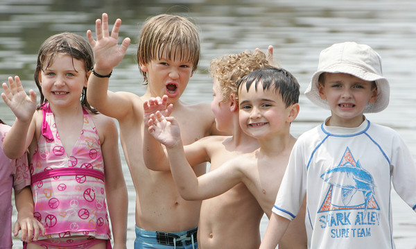 Annika Nyborg, Mack Trotman, Jack Delaney, Noah Willett and Jack Newton from the Plum Cove School enjoy the warm weather on Thursday by spending some time at Plum Cove Beach. Photo by Maria Uminski/Gloucester Daily Times