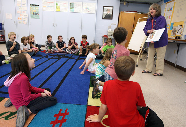 "Essex: Daisy Nell shows Essex Elementary School second graders a finished version of her book, ""The Stowaway Mouse,"" which is based on a song that the students helped write about the Schooner Ardelle. The book was illustrated by George Ulrich of Manchester. Photo by Kate Glass/Gloucester Daily Times"