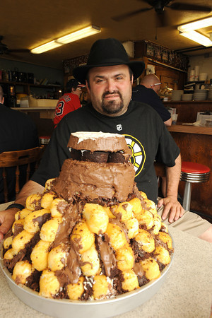 Gloucester:  Matt Legendado Groppo made his own Stanley Cup or Stanley Cake, made from 12 boxes of Twinkies 5 boxes of cup cakes 12 boxes of Cosmic Brownies and 1 pound of chocolate and weighing in at 35 LBS. He has it at George's Coffee Shop for all to see until it gets eaten on Saturday.Desi Smith/Gloucester Daily Times. June 12,2011