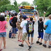 Rockport:  Decorated school buses beeping their horns, pull up to cheering sudents on the last day at Rockport Elementary School Friday afternoon. Desi Smith/Gloucester Daily Times. June 17,2011
