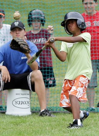 David Le/Gloucester Daily Times. Jayce Rowen, 10 of Rockport, keeps his eyes on the baseball as he takes a cut during the Viking Baseball Camp held at Evans field in Rockport on Tuesday afternoon. 6/28/11.