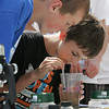 Chris Ambrose and Peter McManus of Rockport Middle School search for underwater creatures during their fieldtrip to Millbrook Park and Front Beach. Photo by Maria Uminski/Gloucester Daily Times