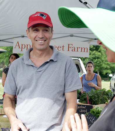 David Le/Gloucester Daily Times. Barry Moir, of Gloucester, chats with Heidi Wakeman, right, at the opening of the Cape Ann Farmer's Market at Stage Fort Park in Gloucester on Thursday afternoon. 6/30/11.
