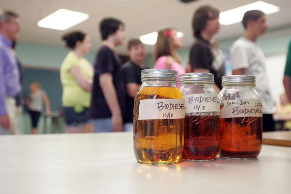 The eighth graders at Gloucester Middle School created biodiesel fuel from cooking grease used at Gloucester High, and built a generator to use it on an ice cream machine. Photo by Maria Uminski/Gloucester Daily Times