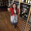 David Le/Gloucester Daily Times. Kathleen Erickson, co-owner of Savour Wine and Cheese on Washington St. in Gloucester. She is standing in front of special wine machines made by Napa Technology that will keep wine fresh for 60 days. Her store will offer 20 complimentary wine selections that all can be stored at different temperatures. 6/28/11.