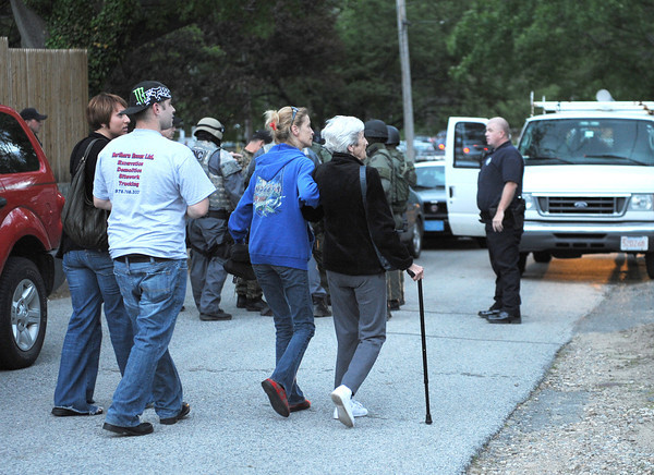 Gloucester: Family members escort their elderly mother from her home on Ashland to safety, place during the 3 hour standoff on Ashland Place Thursday night. Desi Smith/Gloucester Daily Times.