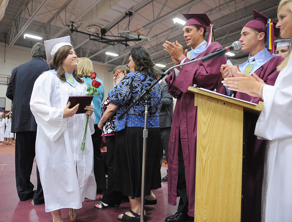 Gloucester: Sarah Taylor proudly walks past her fellow classmates after receiveing her diploma from Principal Dr. William J Goodwin Sunday afternoon at Graduation held inside at the Benjamin A. Smith Fieldhouse.   Desi Smith/Gloucester Daily Times. June 12,2011