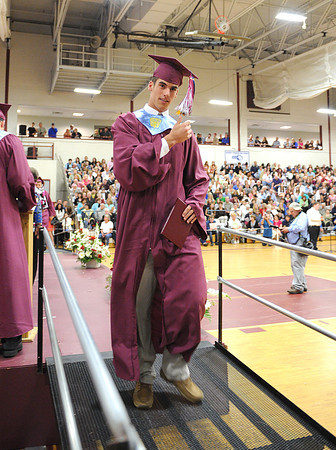 Gloucester: Adam Philpott transfers his tassel to the left side after receiving his diploma,Sunday afternoon at Graduation held inside at the Benjamin A. Smith Fieldhouse.   Desi Smith/Gloucester Daily Times. June 12,2011