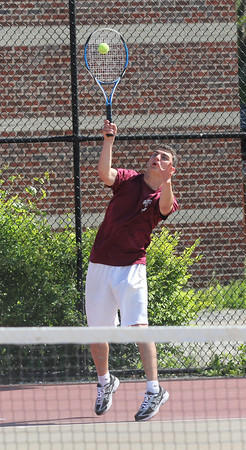 Gloucester's Ben Chianciola serves as he plays second singles during Gloucester's playoff match against Cambridge yesterday. Photo by Kate Glass/Gloucester Daily Times