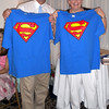 Steve Rowell and his wife, Linda, both longtime Rockport educators, hold up Superman T-shirts they received as gifts during their retirement party  at the Elks Club in Gloucester on Thursday night. Photo by Kate Glass/Gloucester Daily Times
