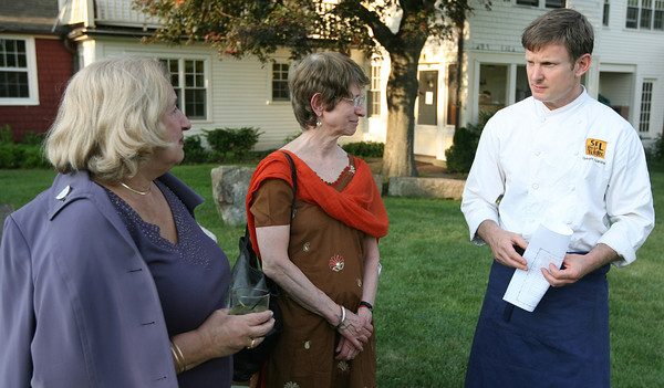 Geoff Gardner of Sel de la Terre speaks with guests at Frank McClelland's home in Essex before they sit down to a farm to table dinner. Photo by Kate Glass/Gloucester Daily Times