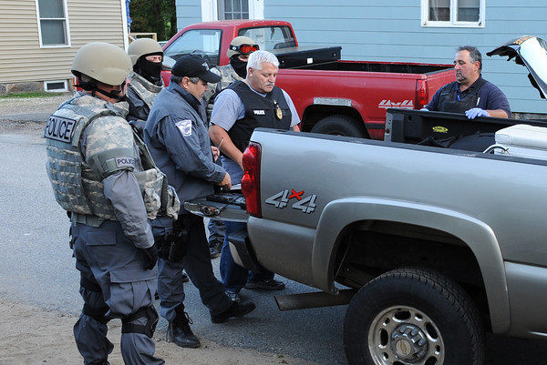 Gloucester: Sgt William Leanos (cap) and Lt Joe Aeillo put together a plan during the 3 hour standoff on Ashland Place Thursday night. Desi Smith/Gloucester Daily Times.