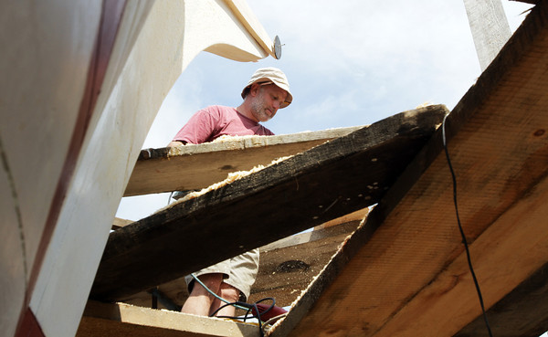 David Le/Gloucester Daily Times. Captain Harold Burnham, of Burnham's Boat Building Company, works on the Schooner Ardelle on Wednesday morning as he prepares to for the launch on July 9th. 6/29/11.