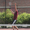 Gloucester's Chase Kelly serves as he plays first singles during Gloucester's playoff match against Cambridge yesterday. Photo by Kate Glass/Gloucester Daily Times