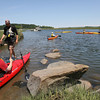 Spencer Griffin of Essex River Basin Adventures helps launch members of his tour group as they prepare to kayak along the Essex River yesterday afternoon. Photo by Kate Glass/Gloucester Daily Times