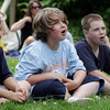 "David Le/Gloucester Daily Times. The Brown brothers from left, Sean, 9, Steven, 10, and Scott, 11, look on in awe as Captain Robbie Bones, played by ""Awesome"" Robb Preskins, performs a magic trick during his Sky Pirate Show at Millbrook Meadow Park in Rockport on Wednesday afternoon 6/29/11."