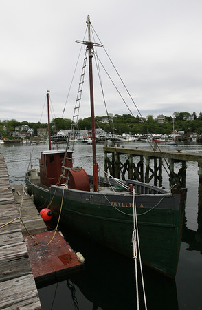 The Phyllis A, which was built in Kennebunkport in 1925 for the Arnold family of Gloucester, had continuously been used by the family as a fishing vessel until 2000. It is now docked at Gloucester Marine Railways and will likely be restored. Photo by Kate Glass/Gloucester Daily Times<br /> <br /> Gloucester Marine Railways on Rocky Neck. Photo by Kate Glass/Gloucester Daily Times
