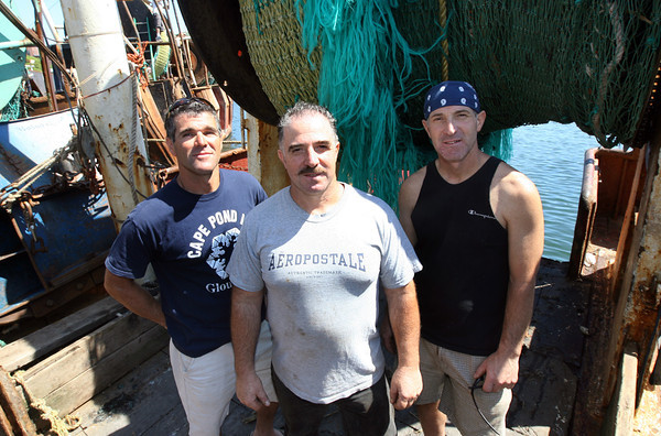"Joe Sanfilippo, Gus Sanfilippo, and Nino Sanfilippo, all of Gloucester, stand on the deck of their fishing vessel, the Captain Dominic. The three are ""Team Fishermen"" in ABC's Expedition Impossible, which premieres tonight at 9pm. Photo by Kate Glass/Gloucester Daily Times"