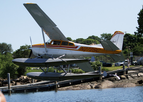 David Le/Gloucester Daily Times. A Cessna 180 water plane piloted by Keith Deschambeault, owner and pilot of Acadian Seaplanes, of Rangeley Maine, turns sharply as it takes off from the Blynman Canal on Friday morning. 7/1/11.