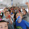 Rockport:  Students celebrate the last day of school with party favors given to them as they got onto the bus, Friday afternoon at Rockport Elementary School. Desi Smith/Gloucester Daily Times. June 17,2011