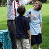 """David Le/Gloucester Daily Times.  Awesome"""" Robb Preskins, also known as Captain Robbie Bones, holds a rope high above the heads of brothers Sean, 9 left, and Steven Brown, 10, right, during the Sky Pirate Show at Millbrook Meadow Park in Rockport on Wednesday afternoon. 6/29/11."""