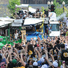 Boston: Zdeno Chara holds up the Stanley Cup to thousands of fans at the Bruins Victory parade held Saturday in Boston. Desi Smith/Gloucester Daily Times. June 18,2011.
