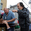 David Le/Gloucester Times. Warren Durgin, left, and Joe Di Maria, right, joke while they prepare the statue of St. Peter to leave on a short procession from St. Peters Club over to St. Peter's Square on Friday evening. 6/24/11.