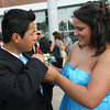 Heather Boudrow helps Meng Eang with his boutonniere as they head to their limo following the Gloucester High School Promenade last night. Photo by Kate Glass/Gloucester Daily Times