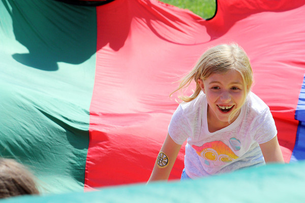 Katie White enjoys a parachute game of cat and mouse during her field day at Rockport Elementary School. Photo by Maria Uminski/Gloucester Daily Times