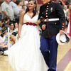 Mark McGlinchey, a member of the United States Marine Corps, escorts his date, Nicolette Parisi, around the Benjamin A. Smith Fieldhouse during the Gloucester High School Promenade last night. Photo by Kate Glass/Gloucester Daily Times