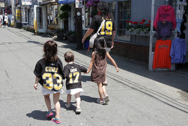 Lizzie Harrison, 4, Caleith Harrison, 2 and Grace Tierney, 4, all of Gloucester, walk with Allison Harrison around downtown Rockport showing their Bruins pride before game 7 of the Stanley Cup. Photo by Maria Uminski/Gloucester Daily Times