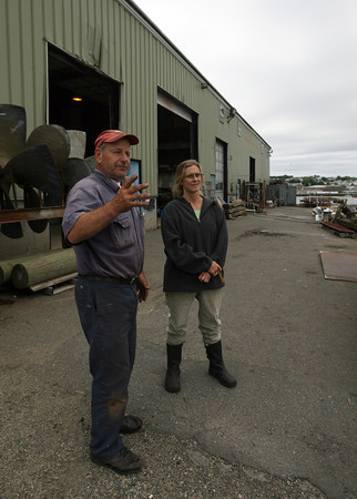 Doug Parsons, docking master, and Viking Gustafson, manager of Gloucester Marine Railways on Rocky Neck, discuss where a boat will be placed for work. Photo by Kate Glass/Gloucester Daily Times